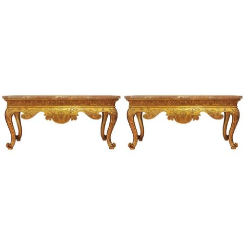 pair of magnificent 19th century gilt consoles with substantial marble tops