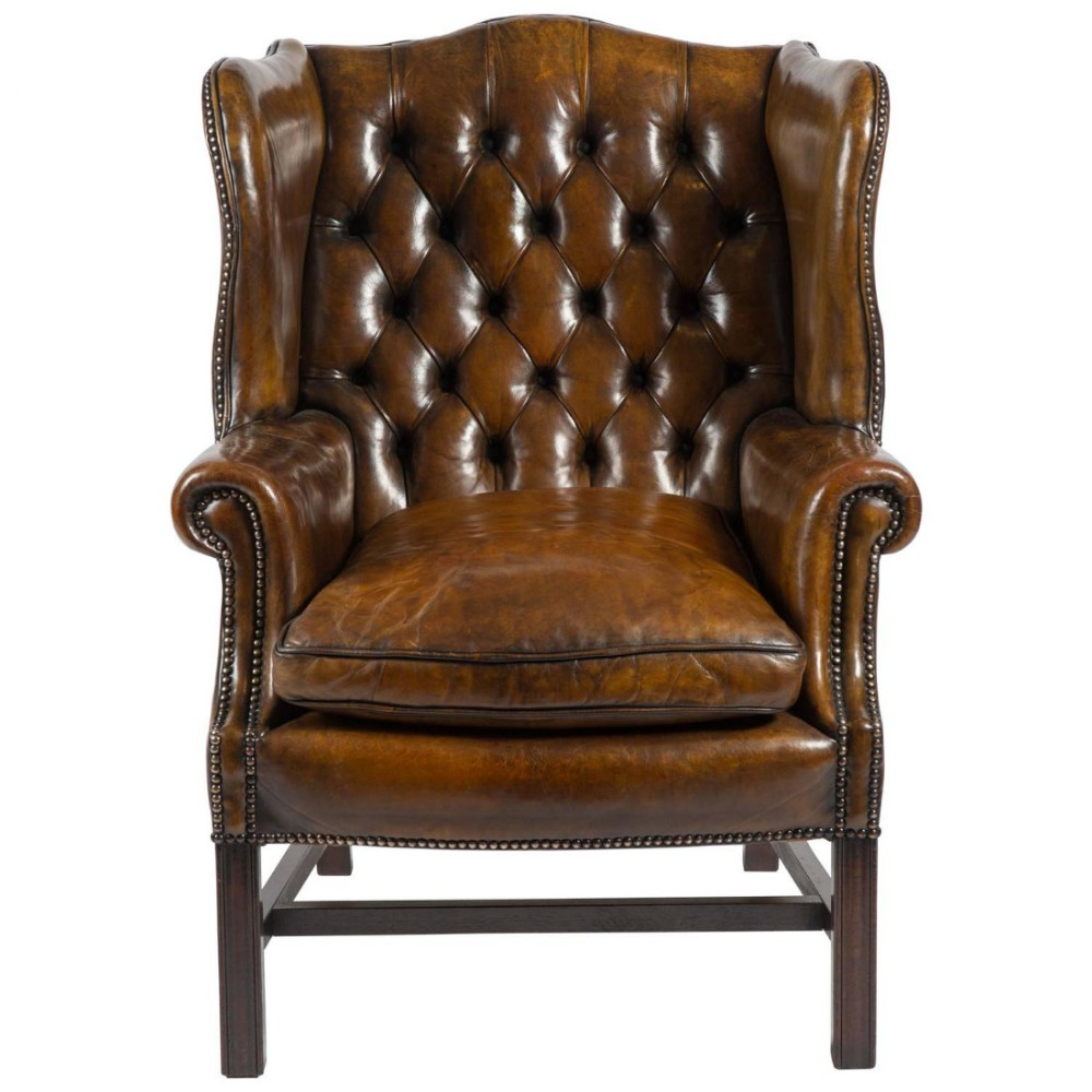 early 20th c leather buttoned back wing chair