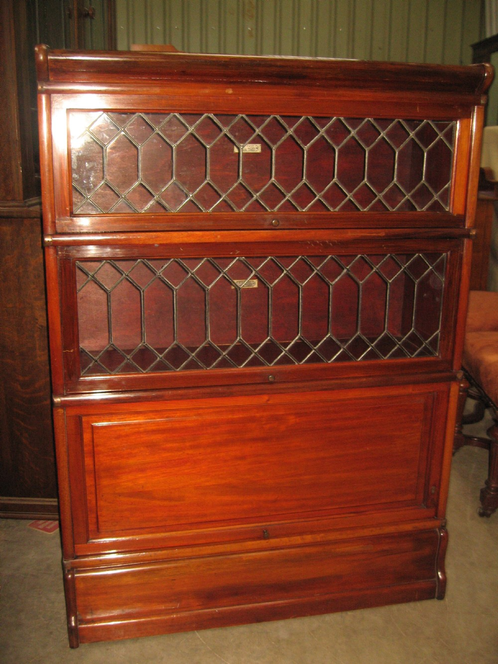 mahogany and leaded glass bookcase
