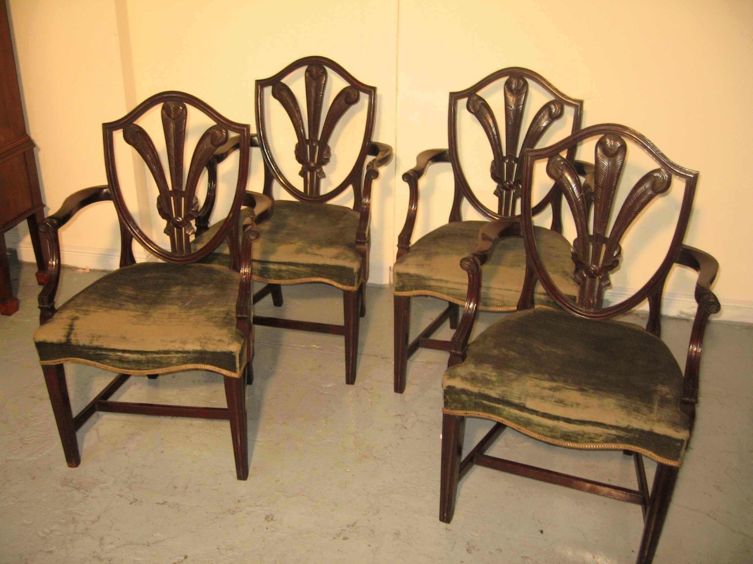 set of four antique style mahogany arm chairs