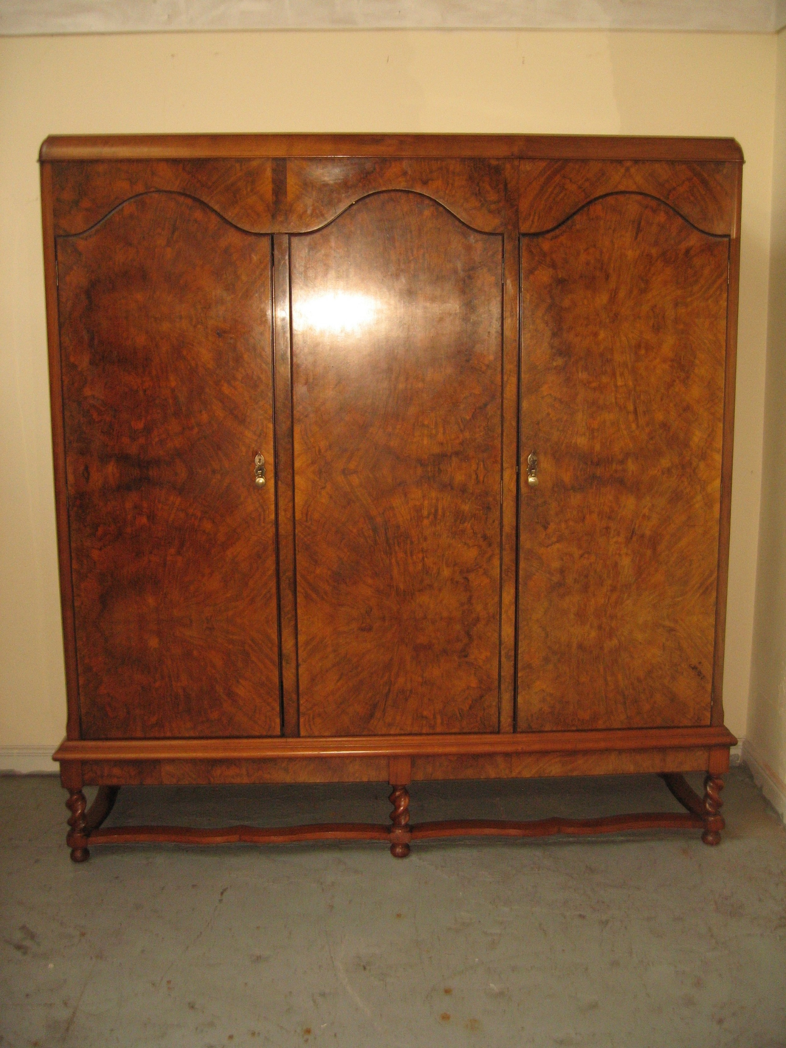 large walnut and burr walnut three door wardrobe