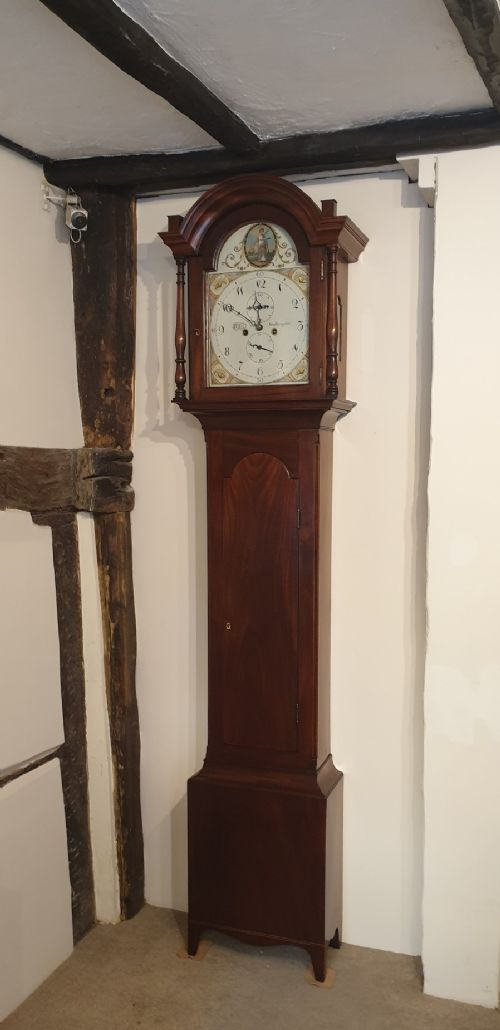 an early 19th century mahogany longcase clock with an attractive painted dial