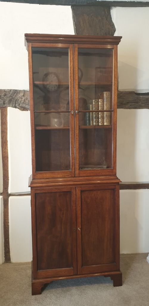 a small and attractive mahogany glazed topped bookcase