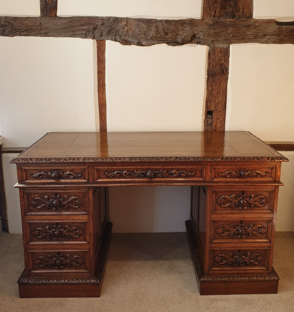 a fine paneled oak pedestal desk by wetson thexton of tottenham court road london