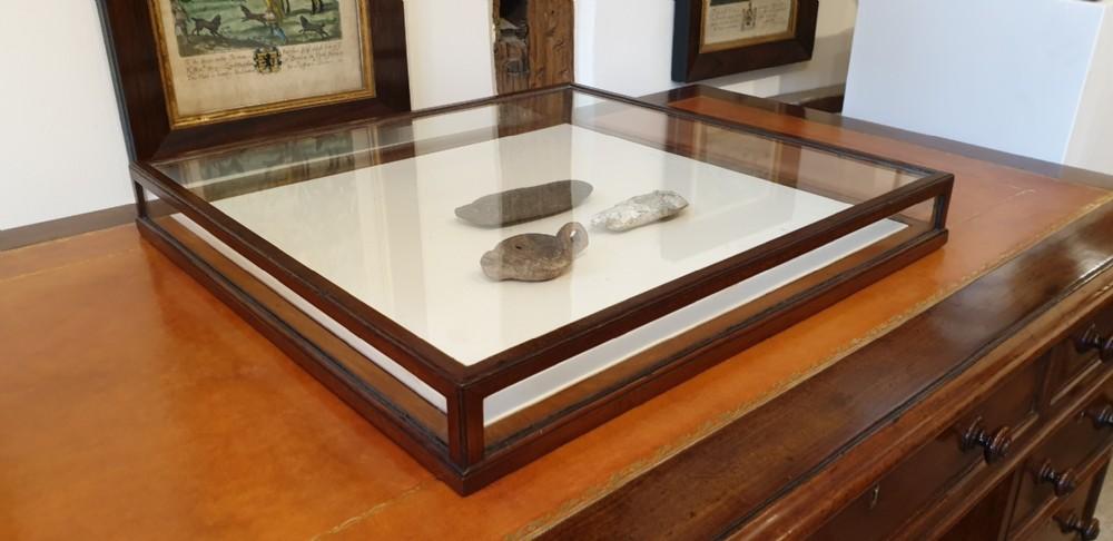 a mahogany table top display cabinet