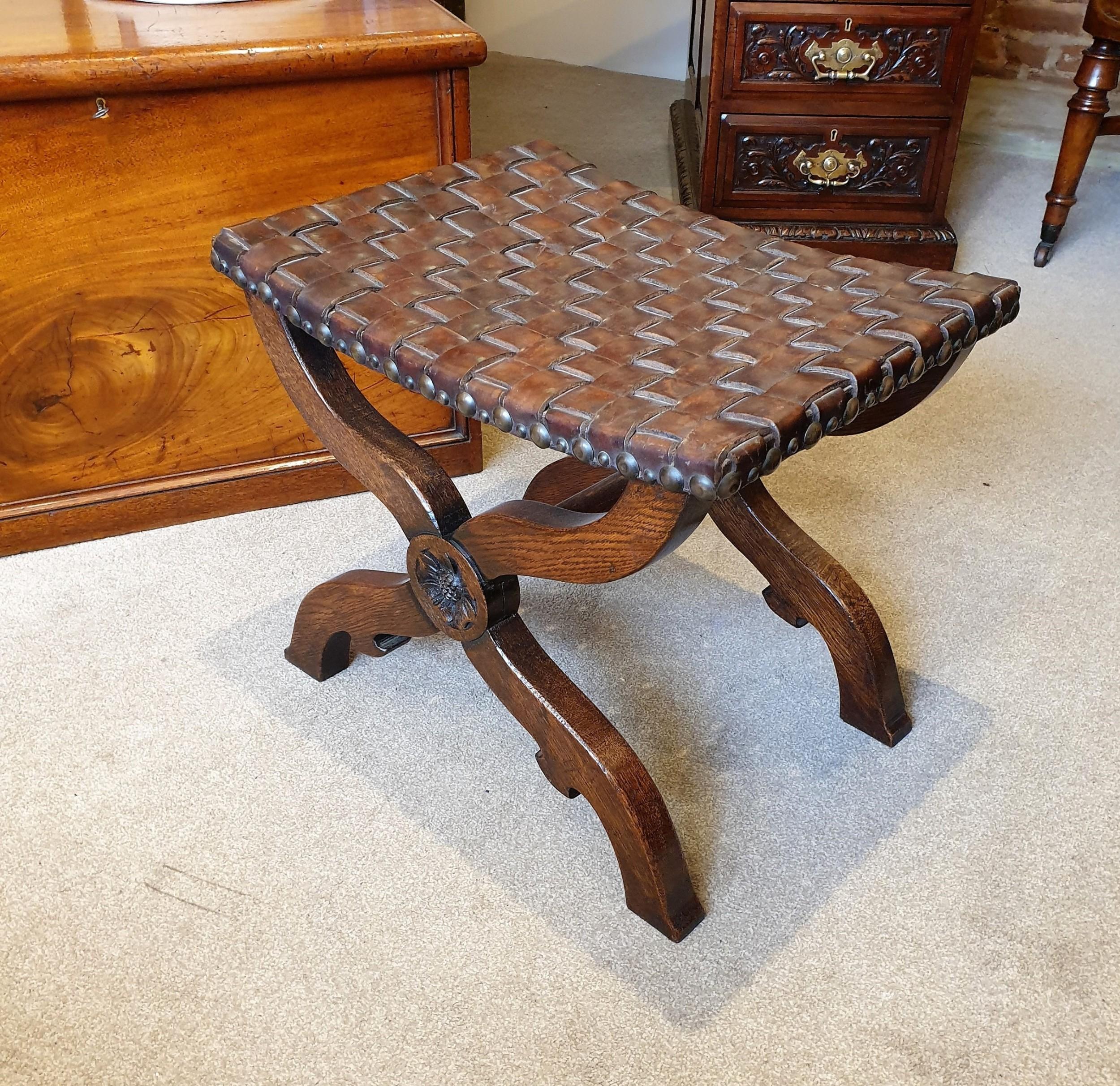 an oak leather lattice seated arts crafts 'x' frame stool