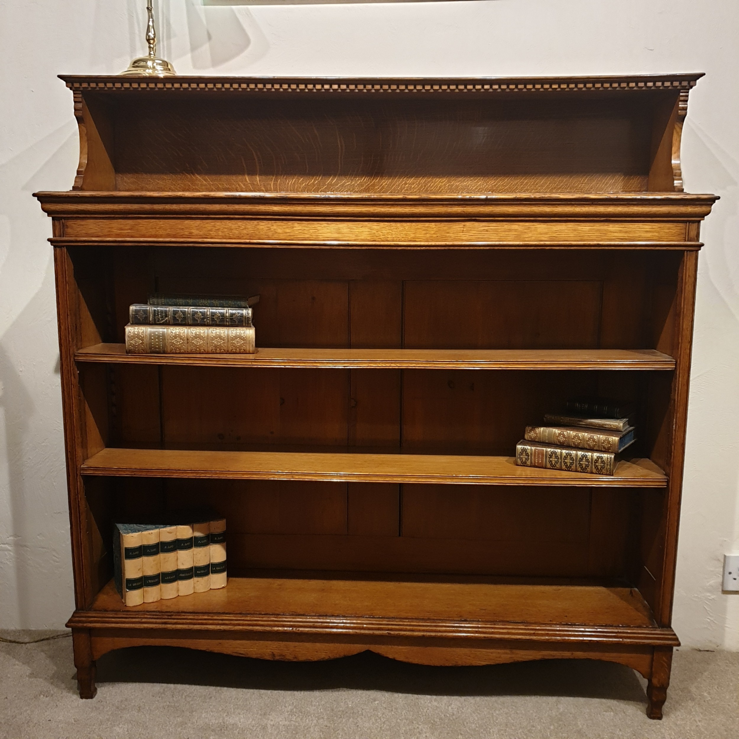 a golden oak open bookcase
