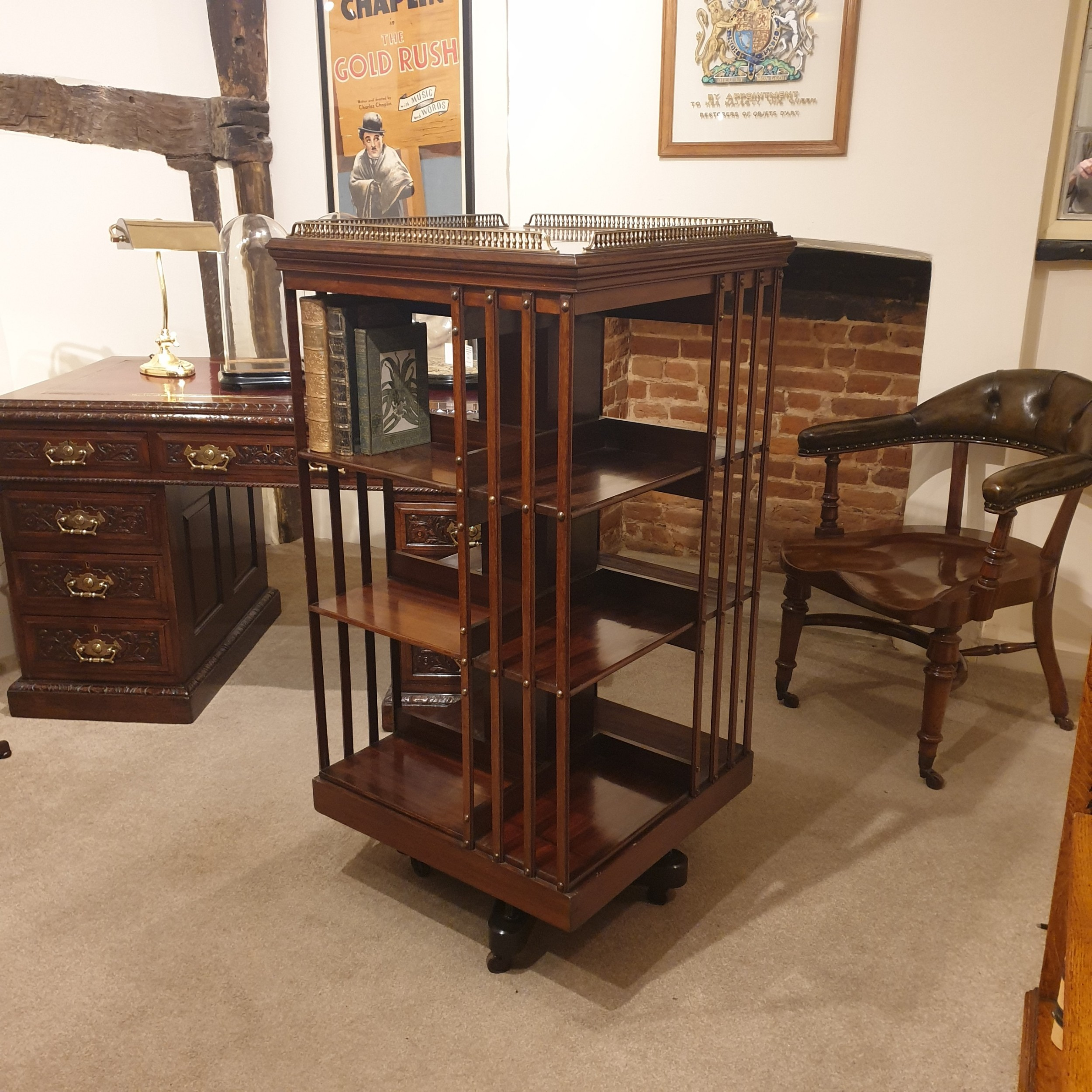 a mahogany revolving library bookcase with galleried top