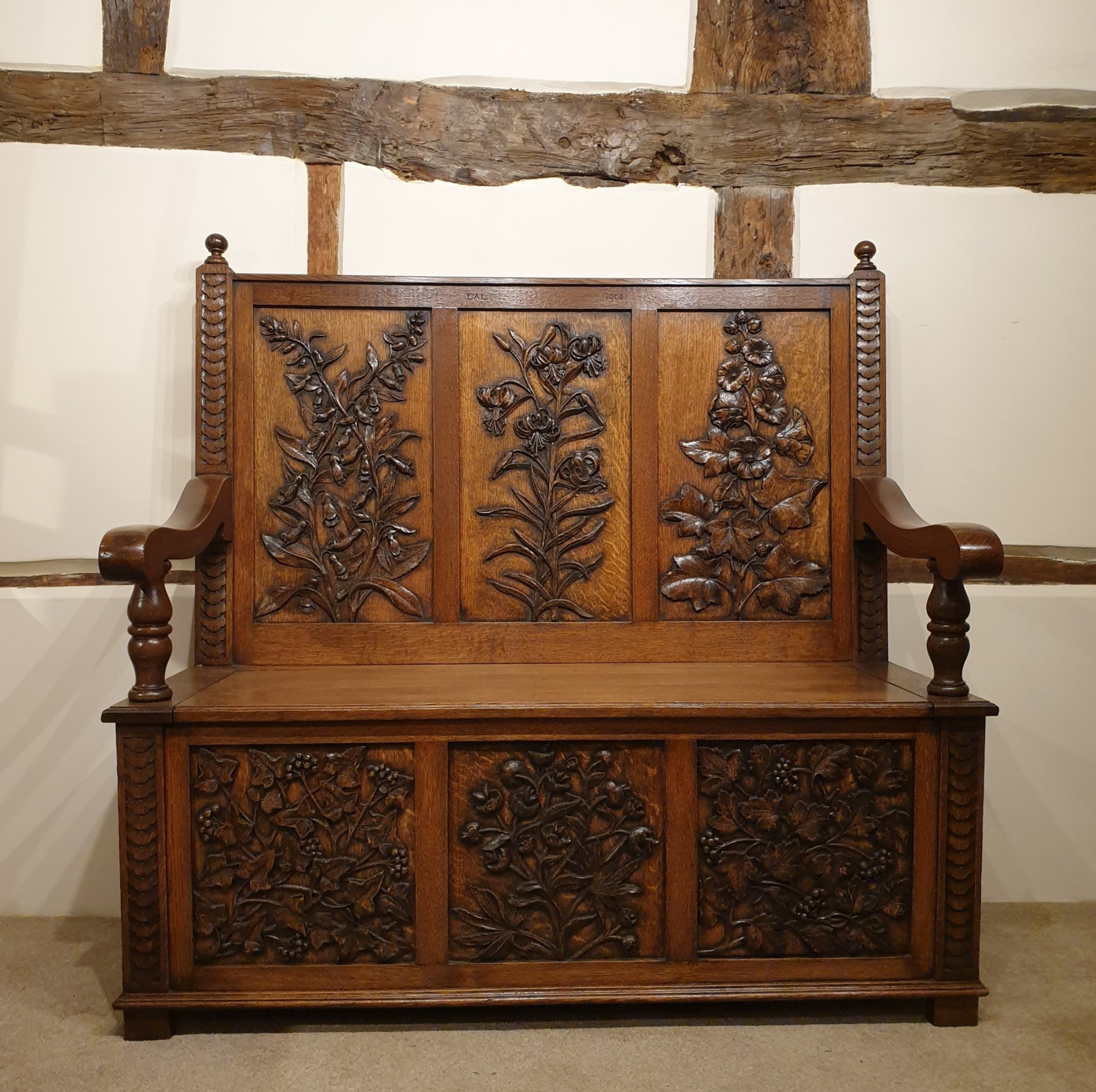 carved oak box settle uniquely decorated with garden flowers initialled dated 1908