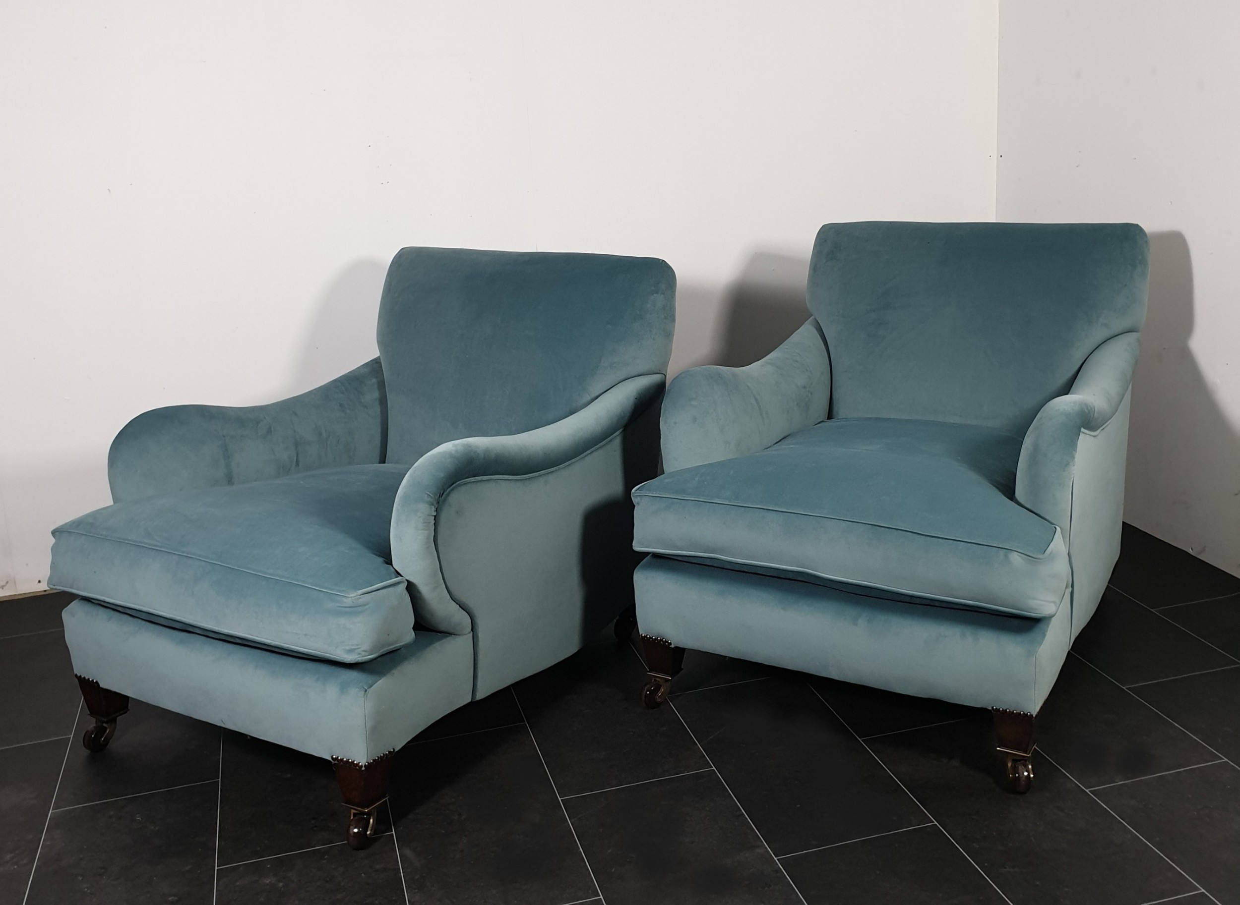 pair of howard style armchairs