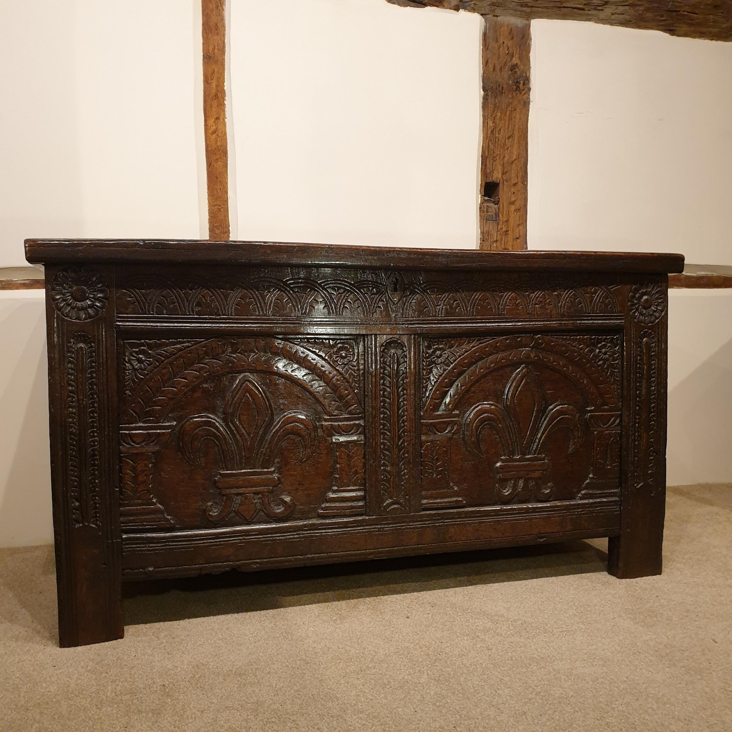 mid 17th century oak coffer with original feur de lis carved decoration