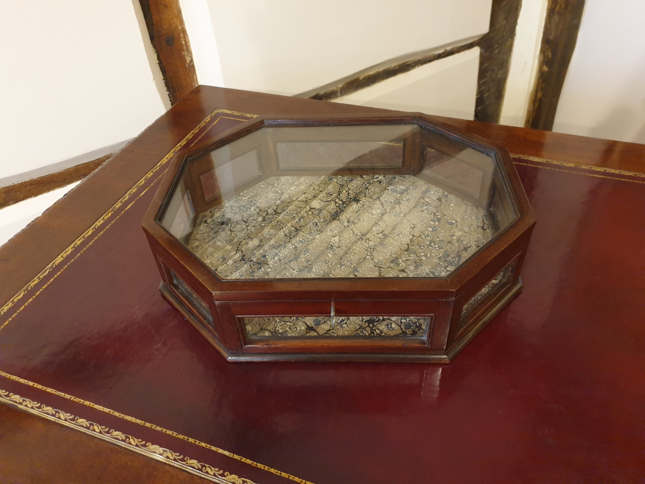 an octagonal mahogany glass sided tabletop display case