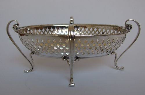 a gorgeous pierced silver sweetmeat basket by goldsmiths silversmiths co - photo angle #3