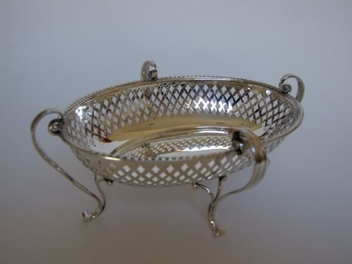 a gorgeous pierced silver sweetmeat basket by goldsmiths silversmiths co - photo angle #2