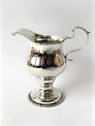 a fine mid 18th century silver cream jug