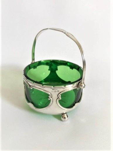 a gorgeous edwardian silver green glass swing handled basket