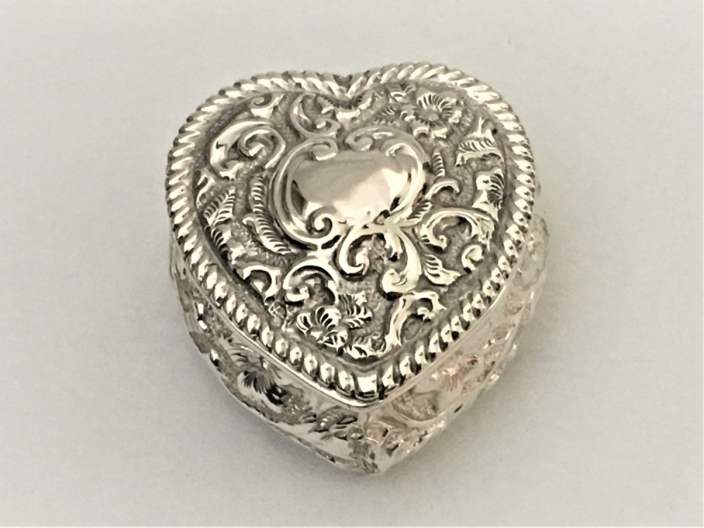 a charming victorian silver heart pill box