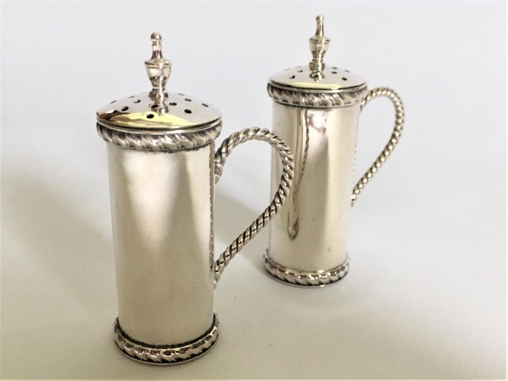 a fine pair of edwardian silver pepper pots