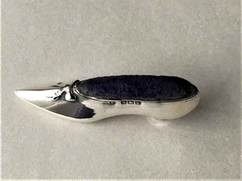 a delightful edwardian silver shoe pin cushion