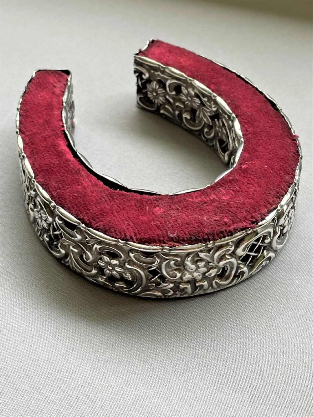 a large victorian 'lucky horseshoe' silver pin cushion
