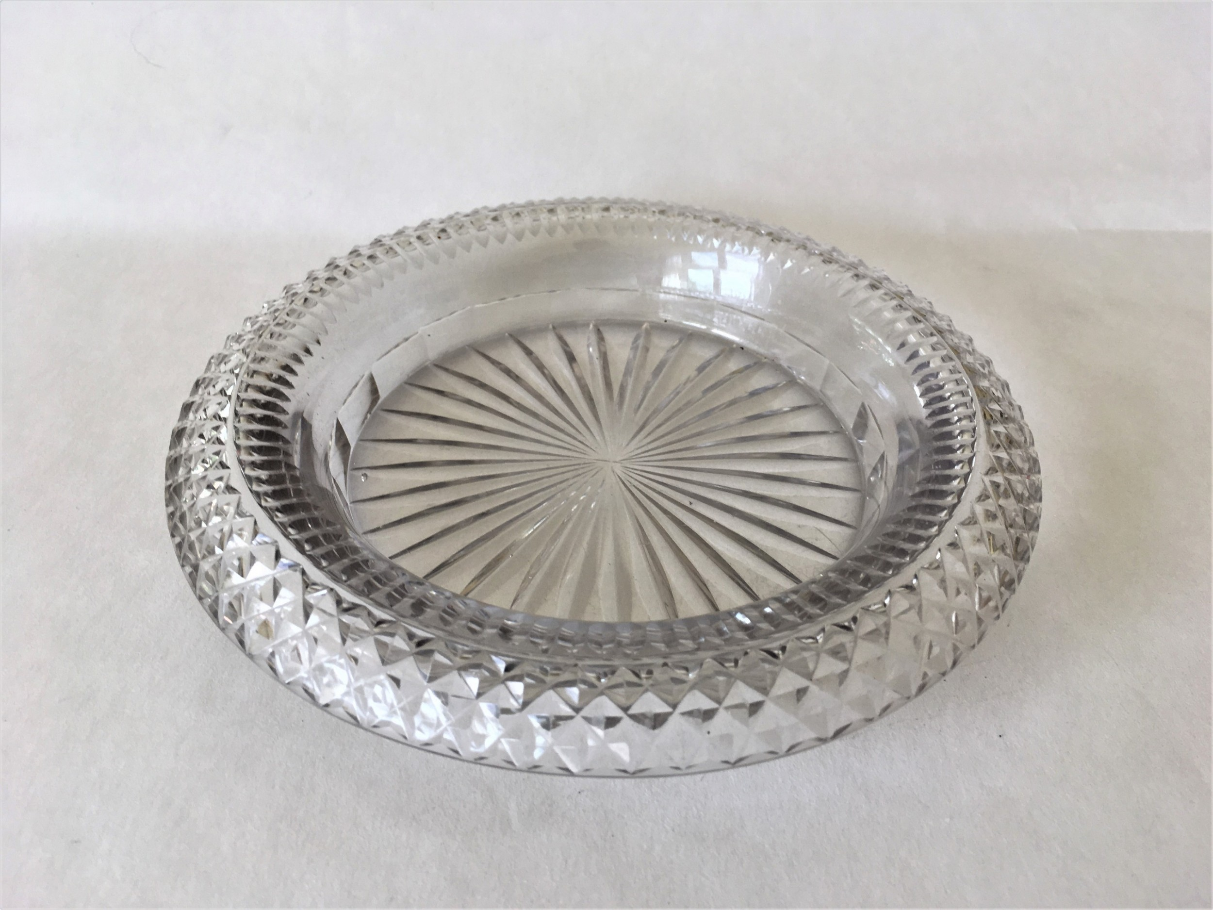 an extremely rare regency cut glass decanter coaster