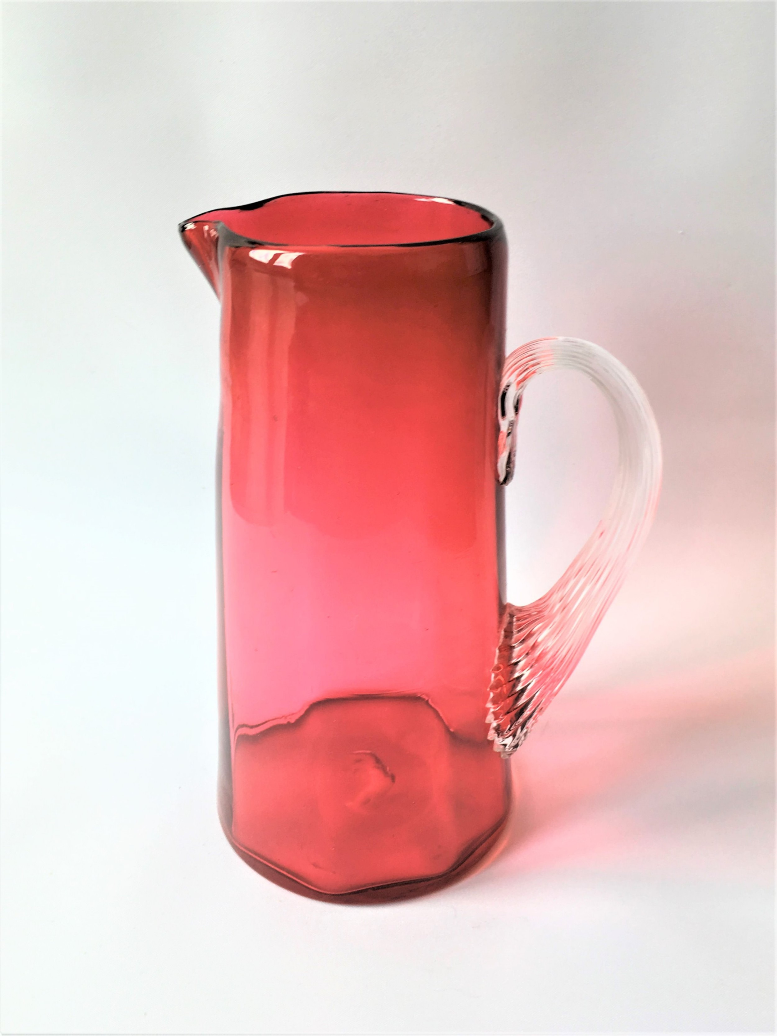 a charming victorian small cranberry water jug