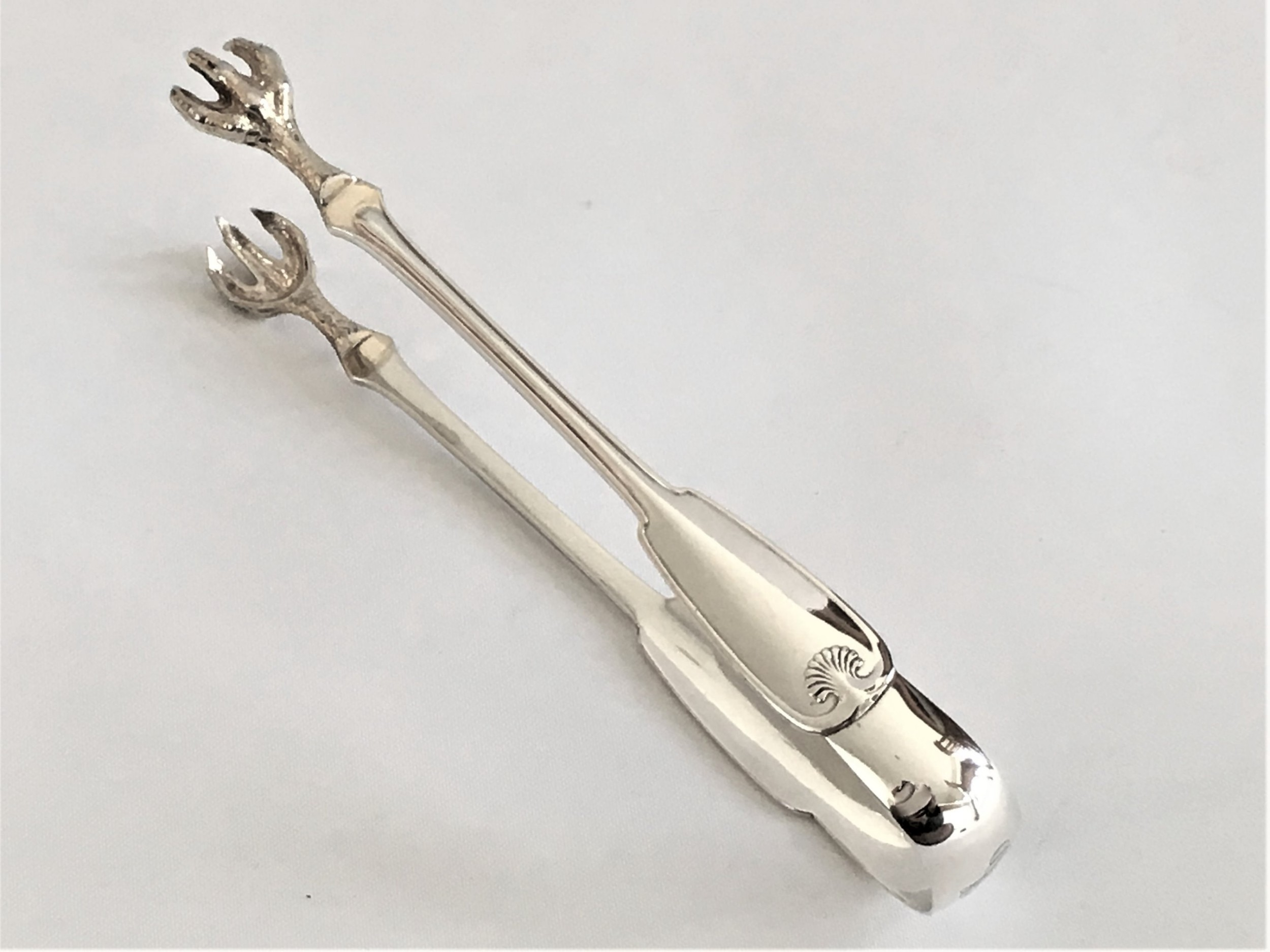 a fabulous pair of tiffany co silver tongs