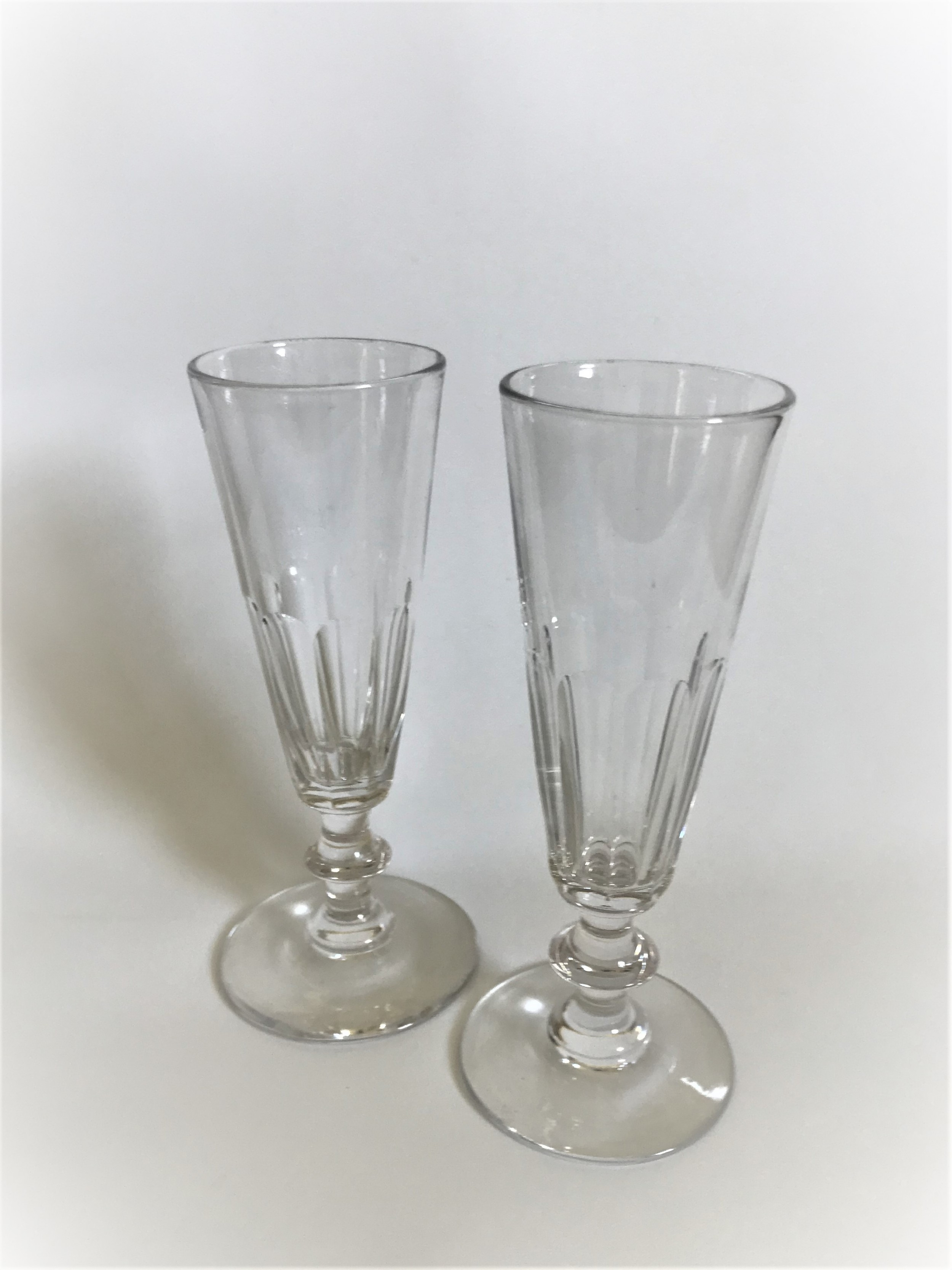 a gorgeous pair of victorian cut glass champagne flutes
