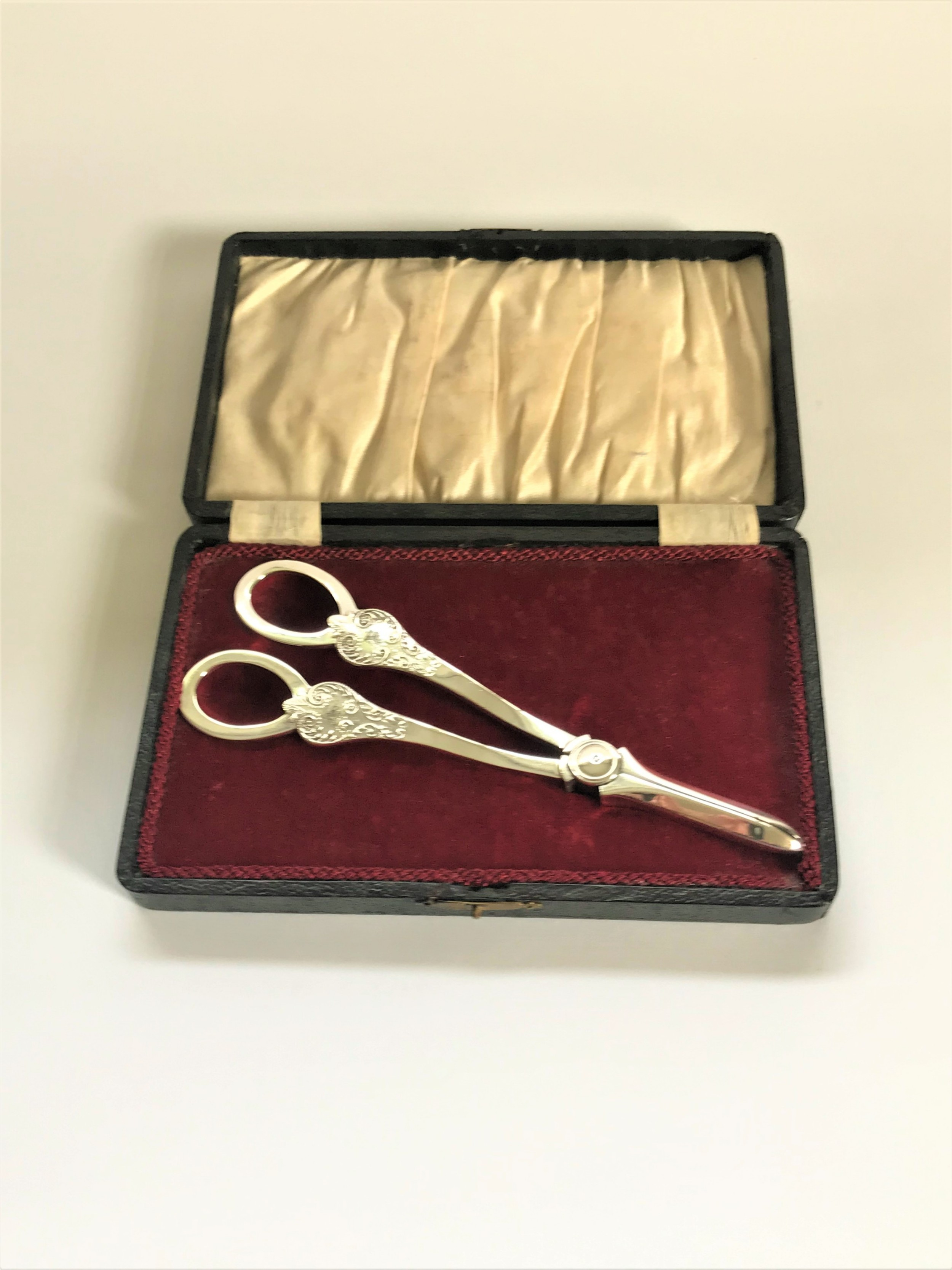 a boxed pair of mappin webb silver grape shears