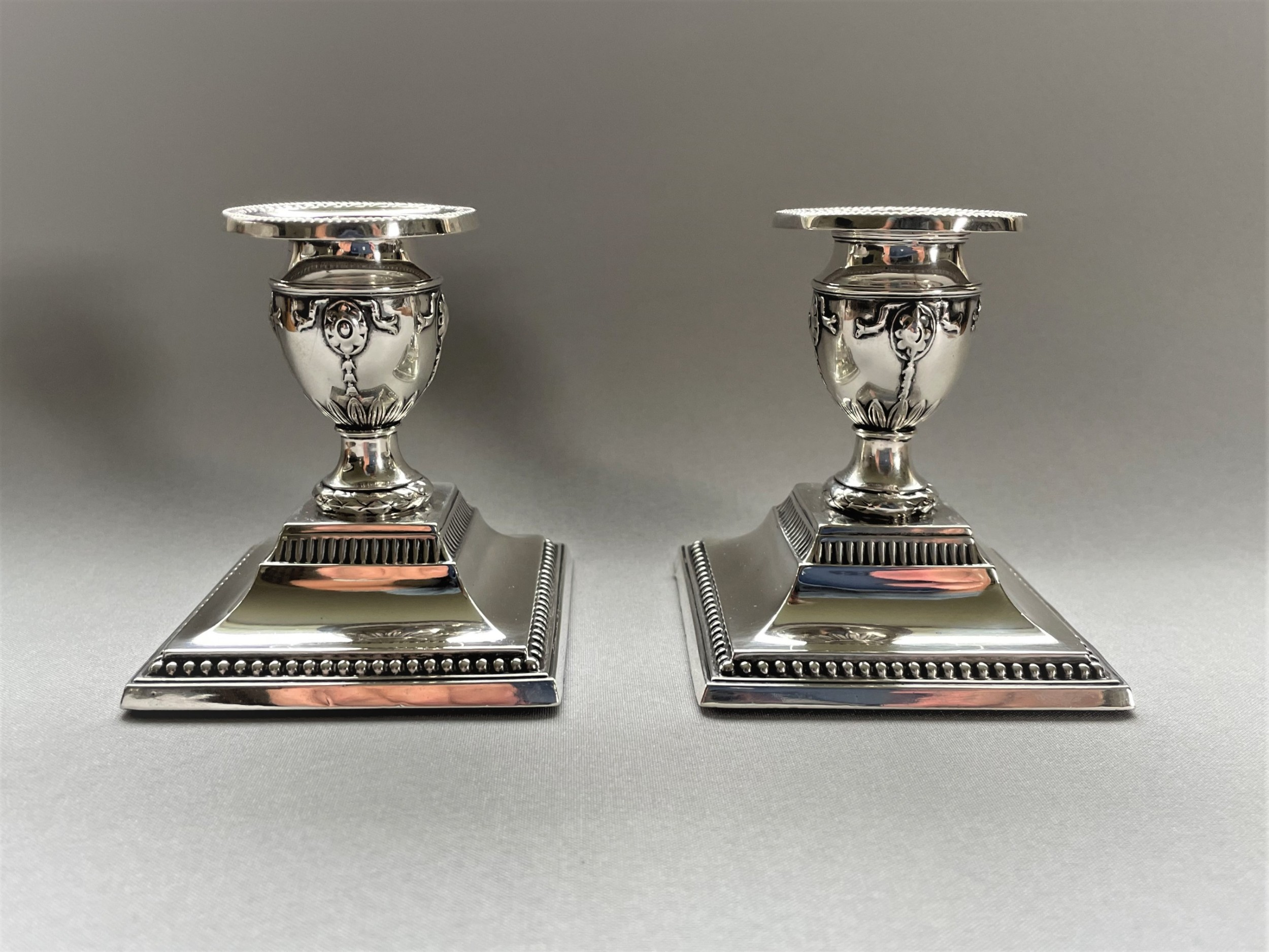 a lovely pair of edwardian silver candlesticks