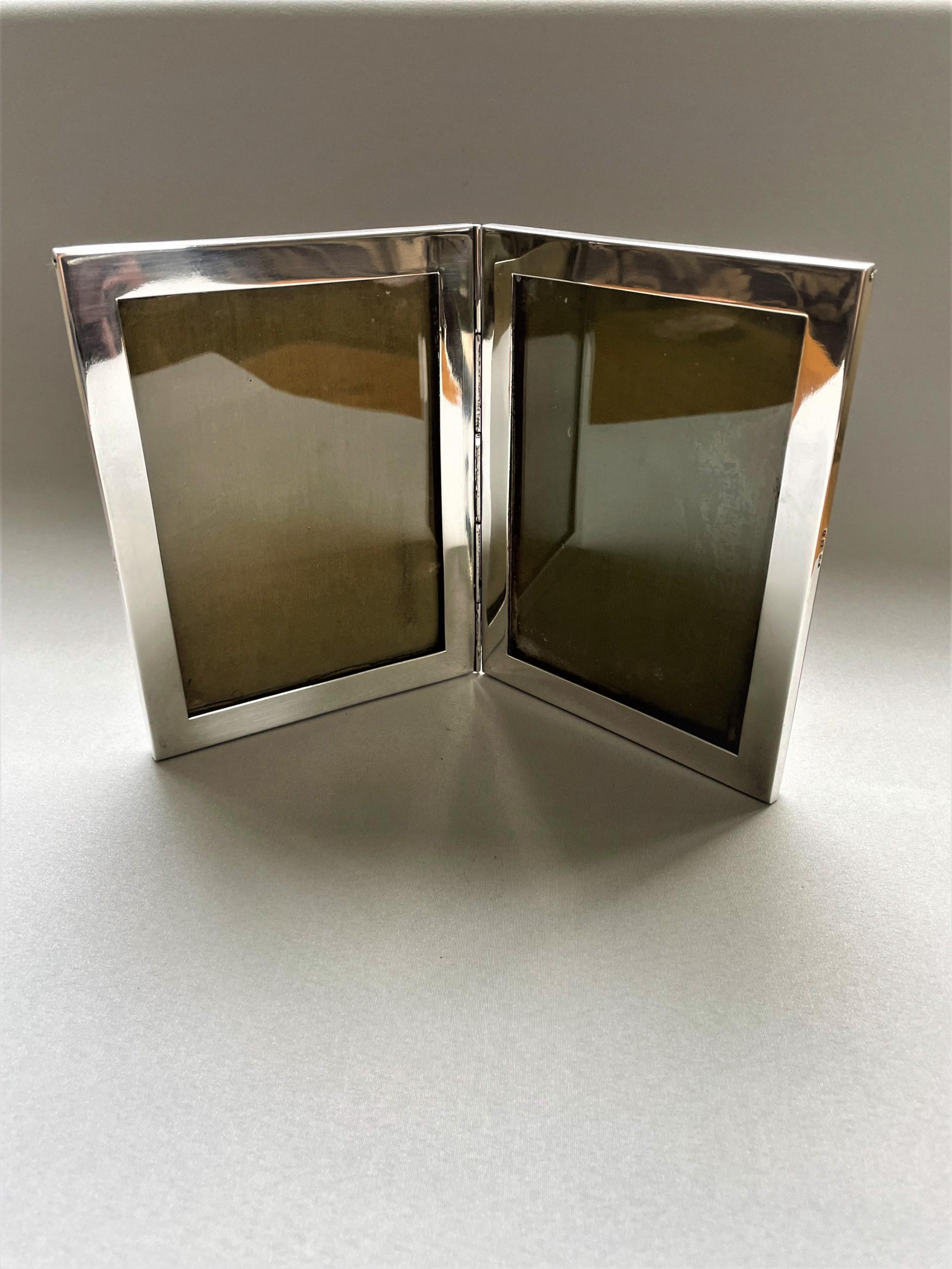 a rare silver double folding photo frame