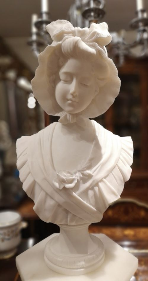 french marble bust of girl wearing a bonnet circa 1900