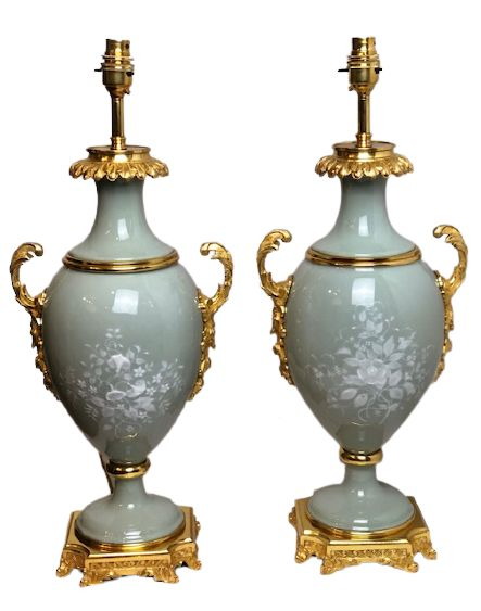 pair of 19th century french patesurpate celadon coloured lamps with floral decoration