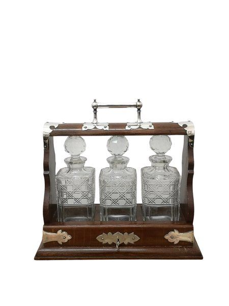 early 20th century oak and silver plate tantalus decanter set circa 1900