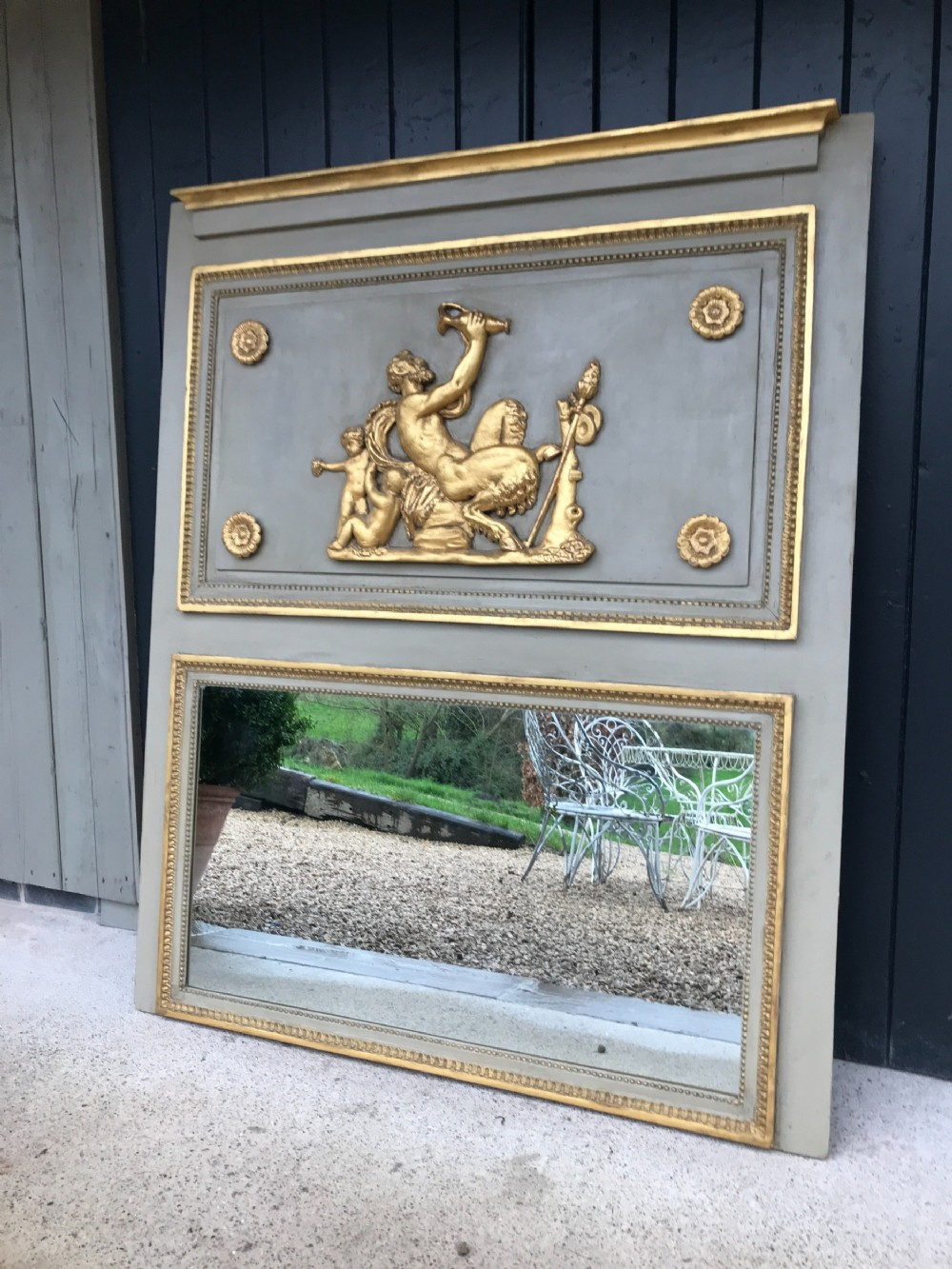 a large french empire trumeau mirror with gilded decoration c 1820