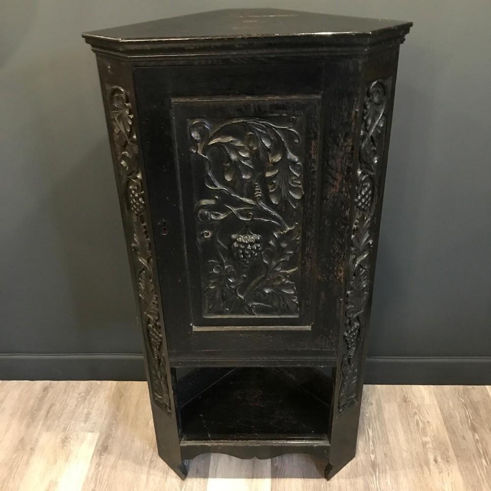 19th century dark oak hand carved corner cupboard
