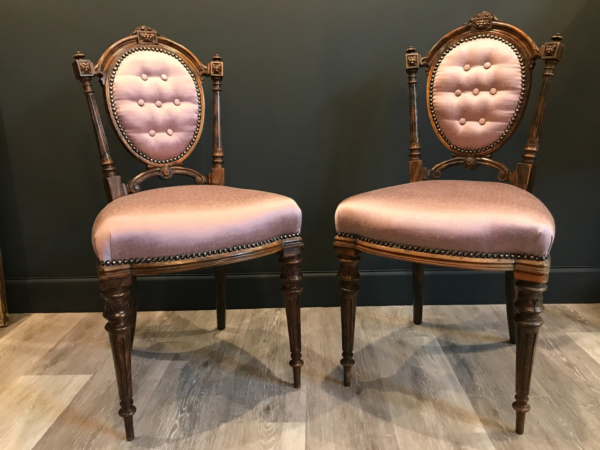 a pair of victorian era french salon chairs in walnut