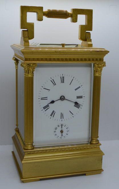 a large strikerepeatalarm corinthian capped striking carriage clock