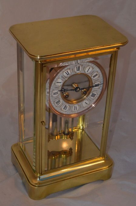 a brass four glass mantle clock by mougin paris
