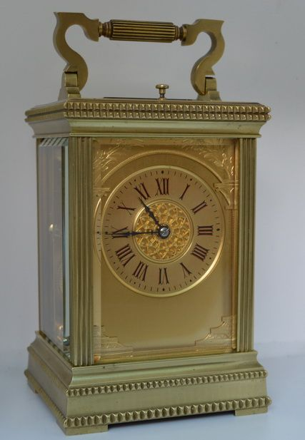a high quality striking repeating carriage clock with an unusual dial