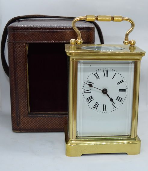 a french carriage clock with its original box