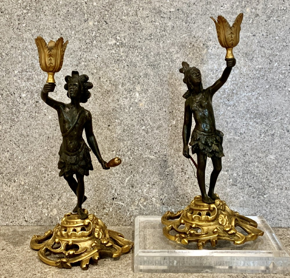 pair of superb bronze patinated cast iron candlestick figures russian