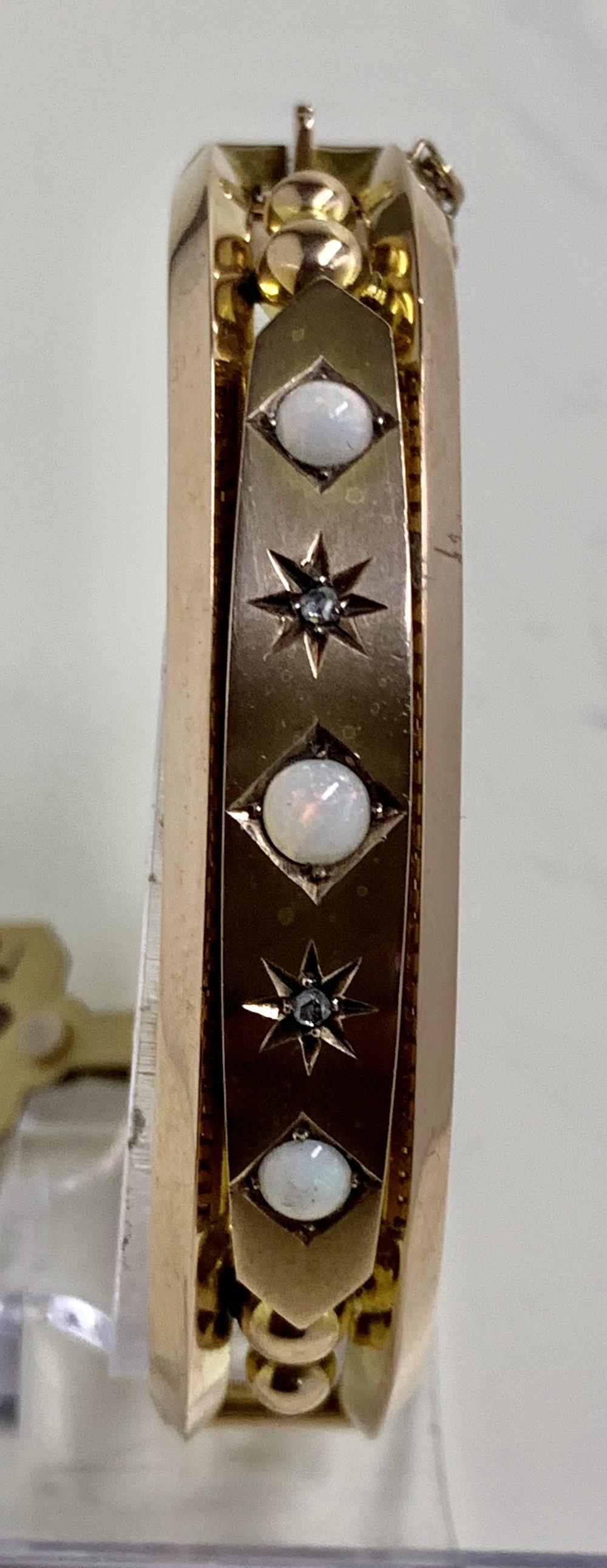 a nice victorian 020 carat diamond and 065 carat opal 9 carat rose gold bangle