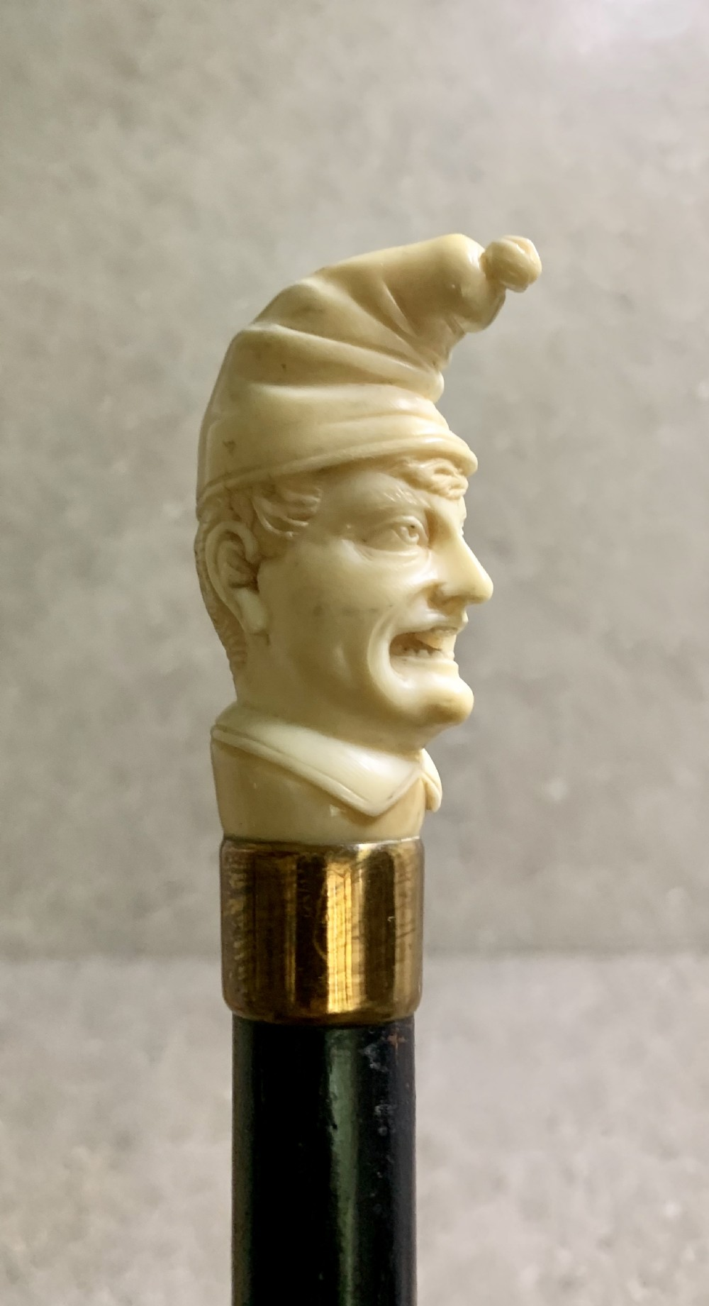 a carved ivory and wood mr punch cane circa 19th c