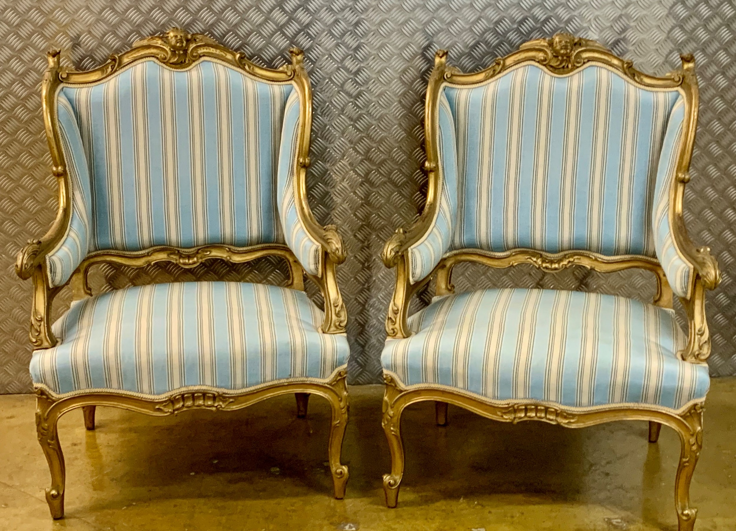 a pair french wing back arm chairs gilt wood frames