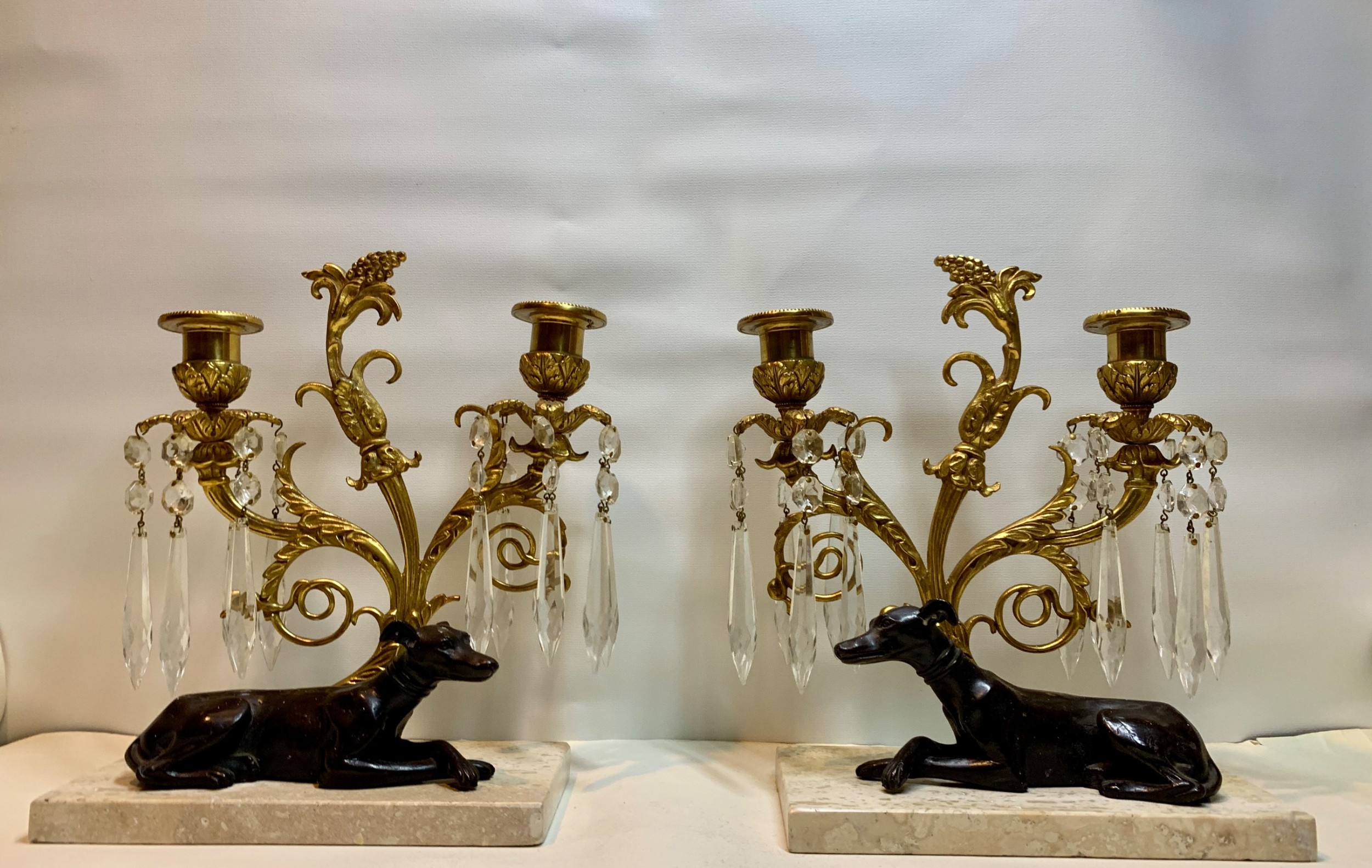a fine pair of regency greyhounds gilt bronze and marble mounted cut glass twin light candelabra