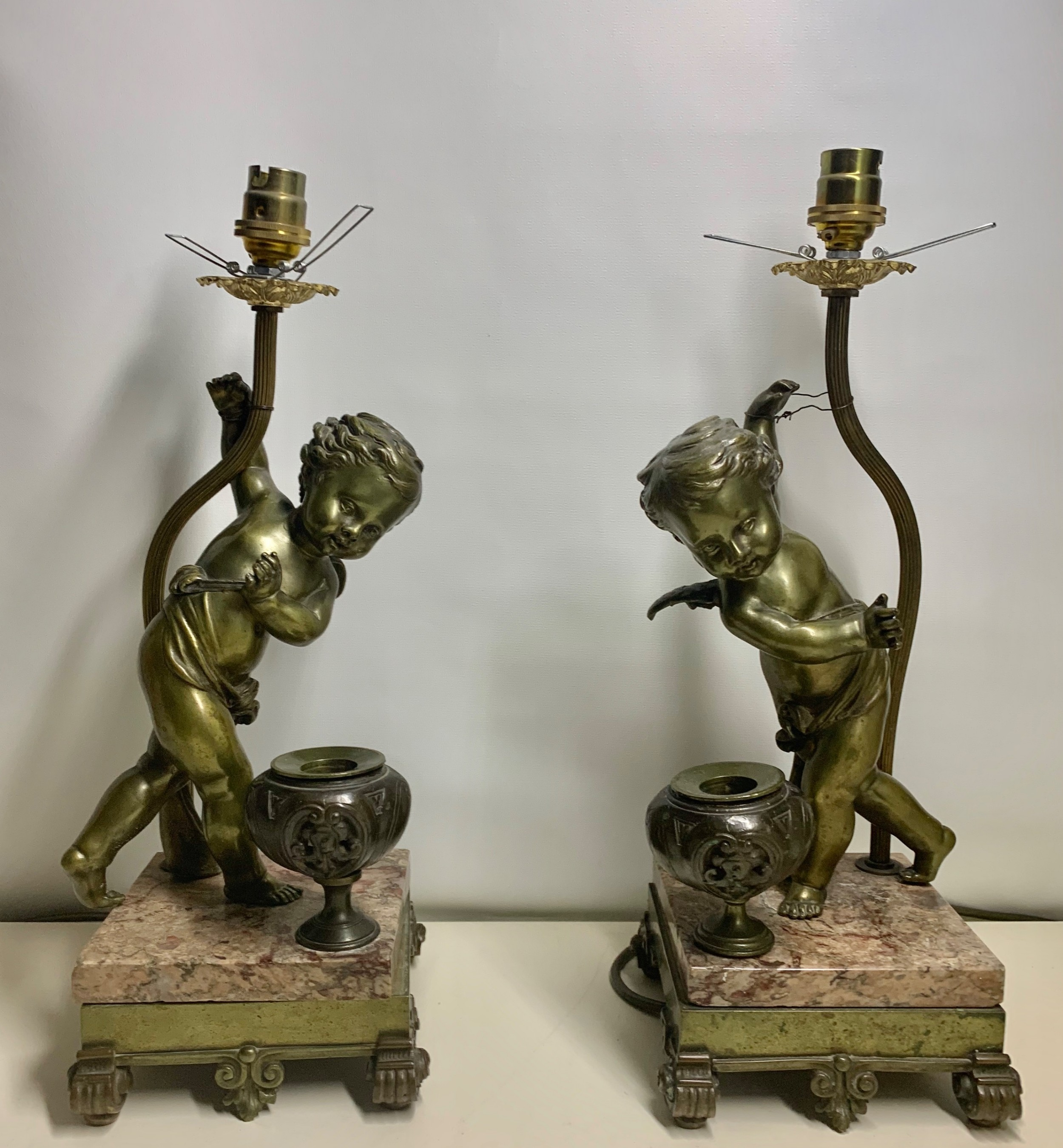 a large pair of bronze dancing cherub table lamps french circa 19th century