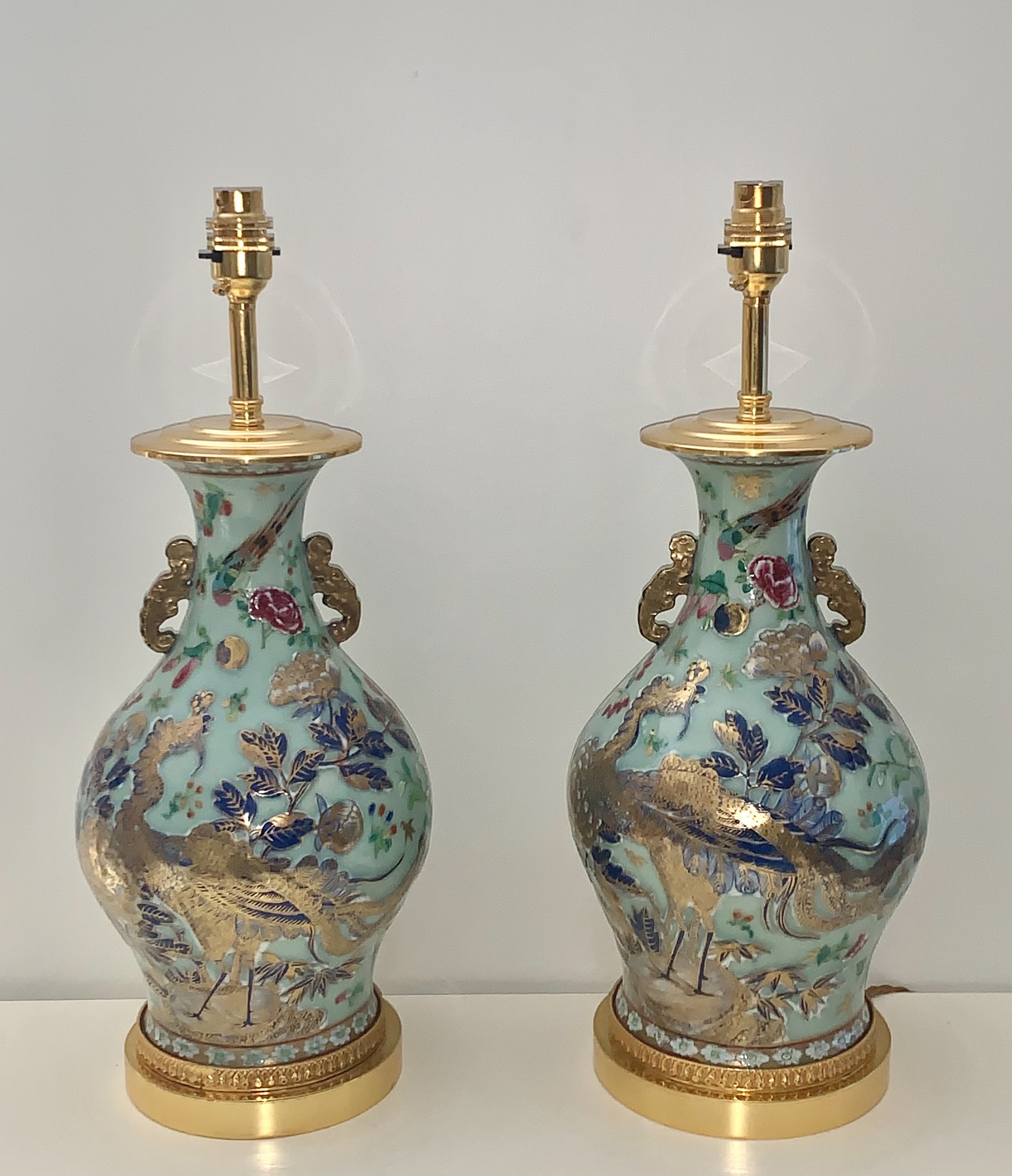 a pair of chinese giltbronze mounted famille rose celadon lamps 19th c