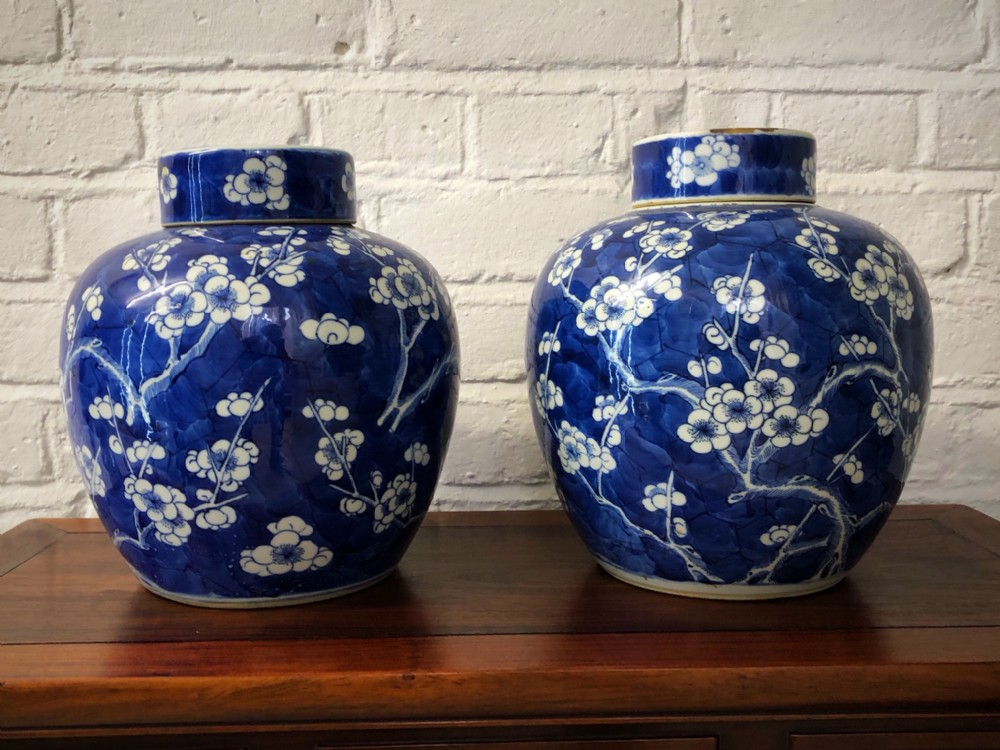 a pair of 19th century blue and white ginger jars with lids