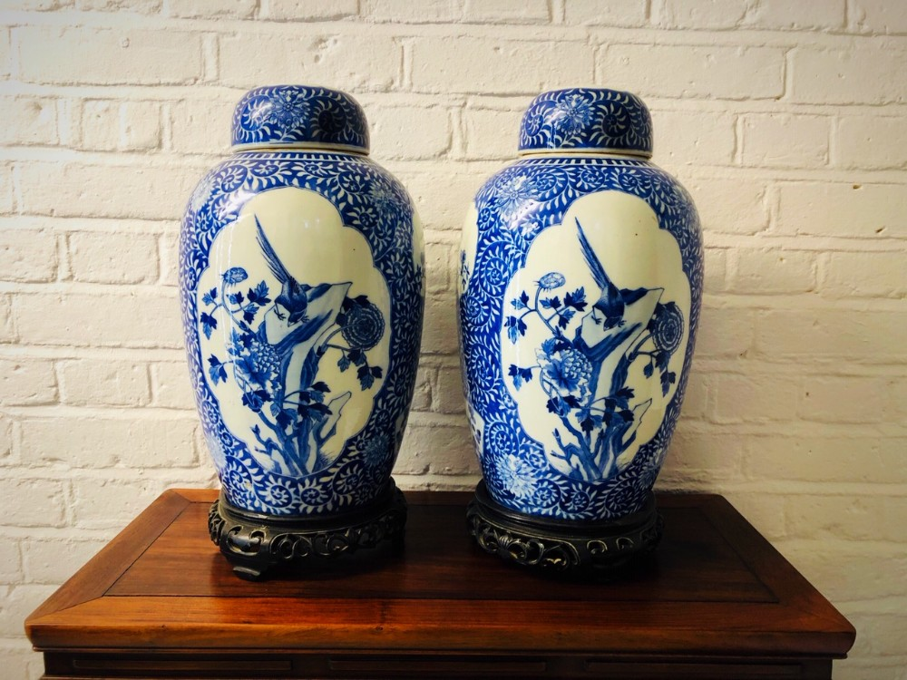a pair of chinese antique elongated blue and white ginger jars